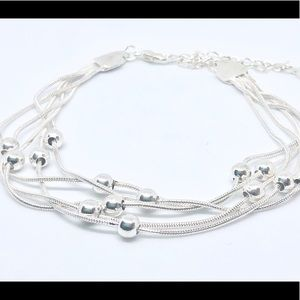 Stunning  .925 Sterling Silver 5 Layered Bracelet.